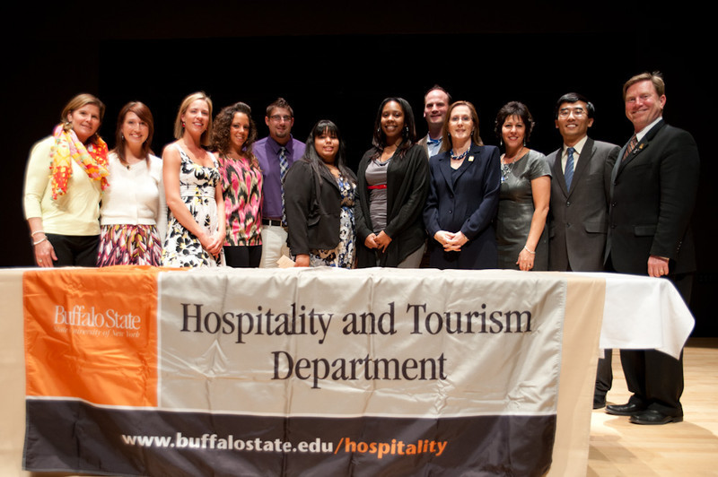 Hospitality Department students & faculty holding a banner