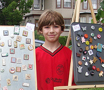 Child exhibiting his art at KidBiz, an event organized by the Buffalo State SBDC