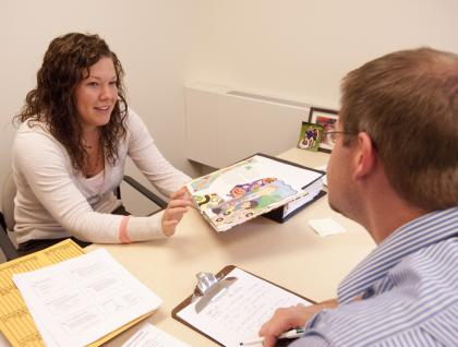 Speech-Language-Pathology clinic supervisor meeting with graduate student