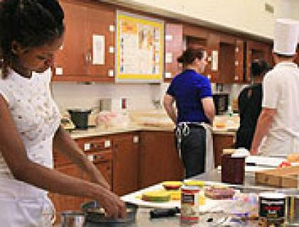 Students cooking in Hospitality kitchen