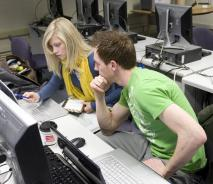 CIS students working together on a computer