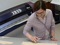 Student using CAD/CAM lab equipment
