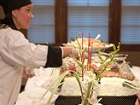 Students catering an event at Campus House