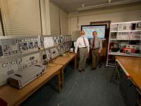 Engineering faculty members standing in Smart Grid lab